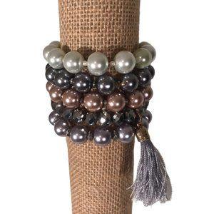 Stack of ALI KHAN c.A.K.e Bracelets Tassel Beads